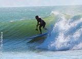 Coaching SUPdans les vagues de la région d'Agadir au Maroc - voyages adékua